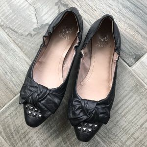 Black bow and studded flats